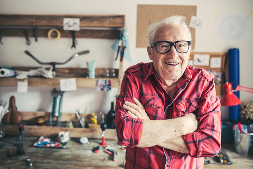 Smiling older man in workshop