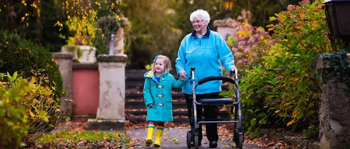 Lady with walker enjoying the outdoors with her grand daughter